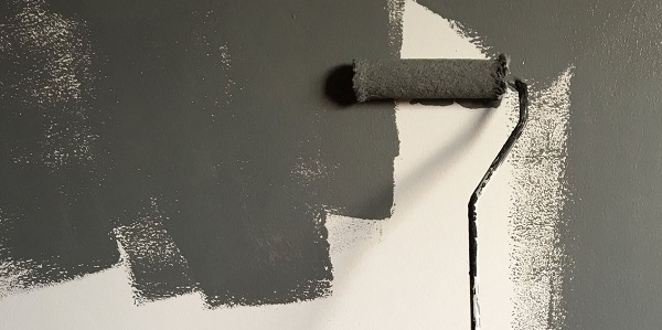 can you paint over damp proof paint